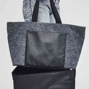 Gray fleece, black leather travel tote from DSW